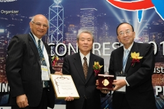 IAQ BQiG Medal to Mr. Sakane Chairman Komatsu Ltd. in HK 2012